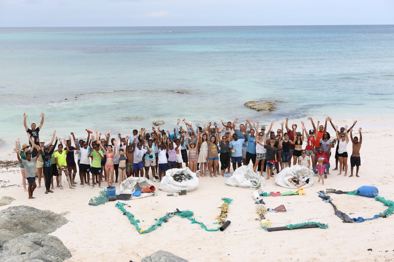 Summit attendees, 5 Gyres, and Jack Johnson celebrate World Environment Day on June 5 and show off all of the beach plastic they gathered.