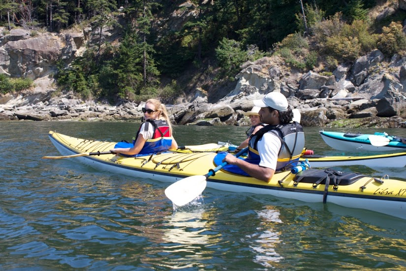 Candice and Kinship Conservation Fellow, Siddharth, kayaking during the July 4th field trip at Larrabee State Park