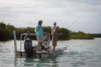 Denny Rankine assists the team in catching bonefish in Savannah Sound.