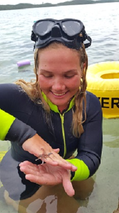 Lili Wagner finds a baby octopus on the light trap