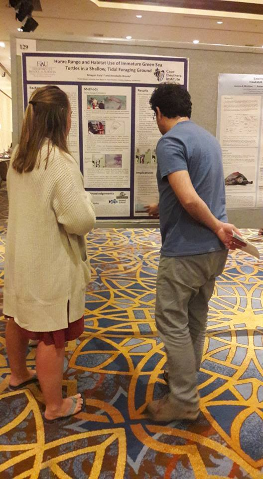 Meagan discussing her research with symposium attendees