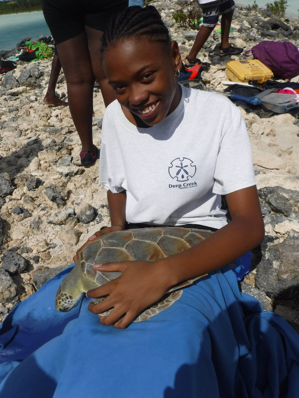 A student from Deep Creek Middle School assisting with the turtle workup.