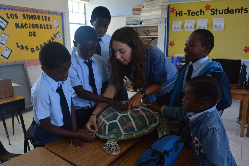Jess Rudd teaches students at Current Island all-age school.