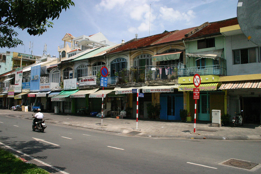 Two-storey colonial shophouses at 26-56 Võ Văn Kiệt, District 1.
