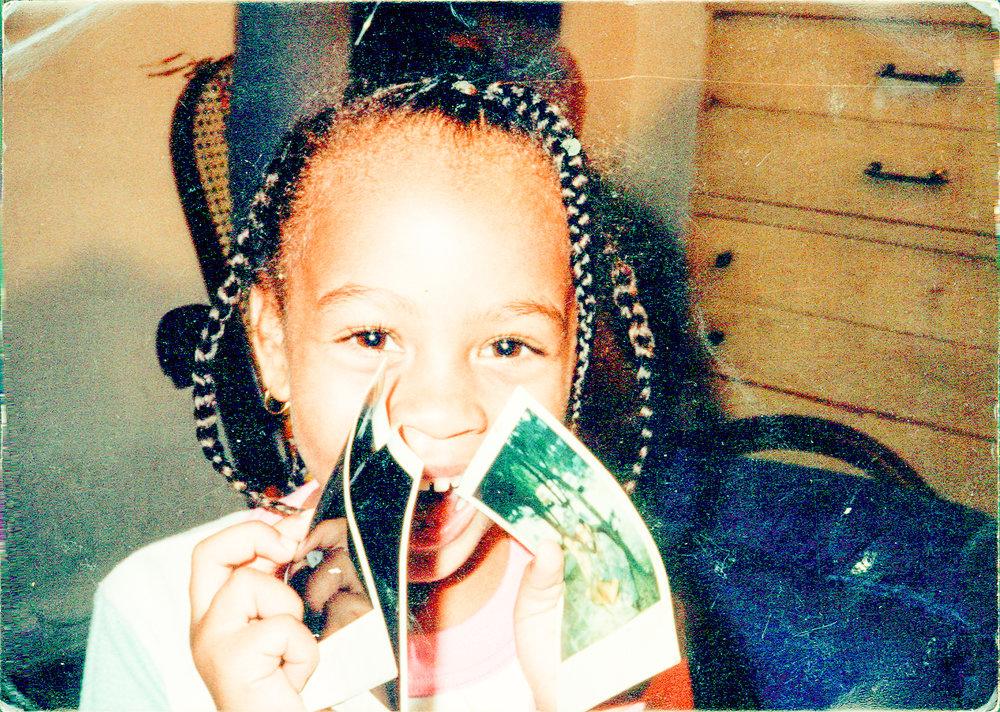 Holding my polaroids at Grandma Jackson's house
