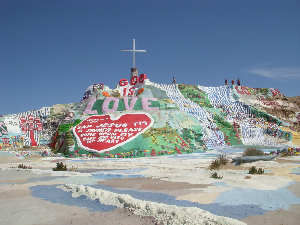 Salvation Mountain is made out of adobe.  There is nothing but sand beneath it.  I can't imagine it will be there forever.  Eventually, the sands of the desert will reclaim it.