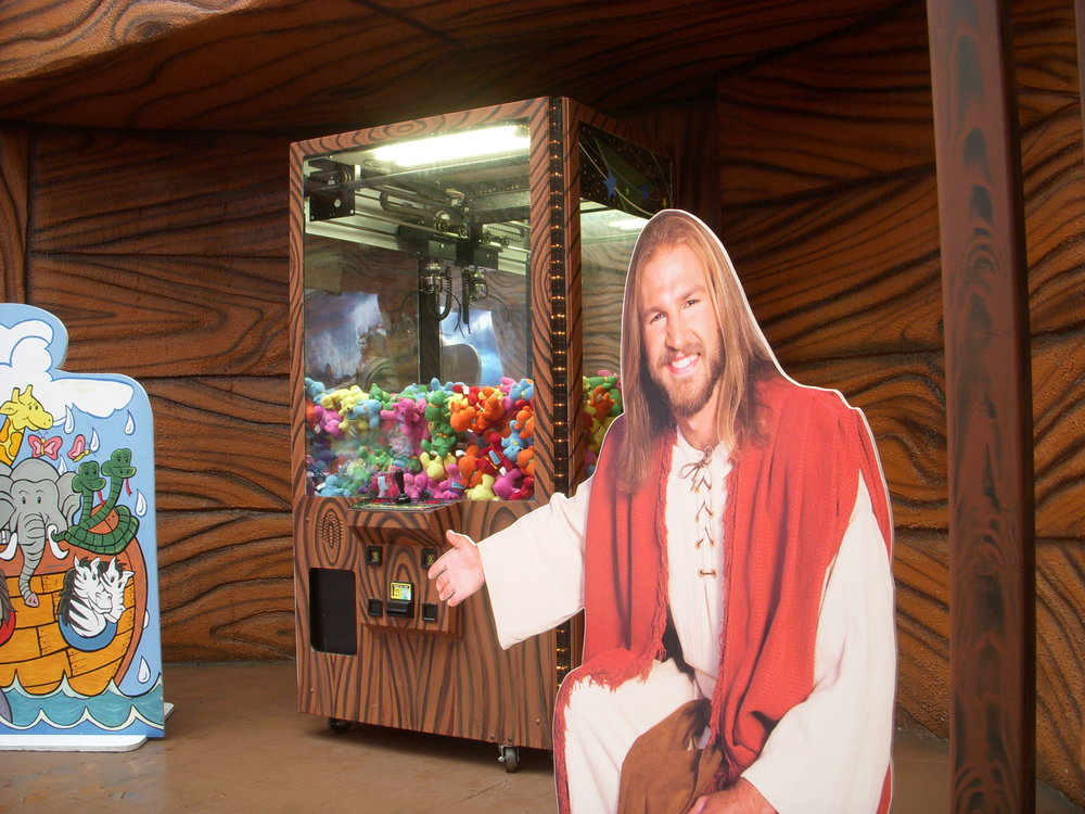 Blond Jesus wants your children to throw a couple bucks in the toy machine.