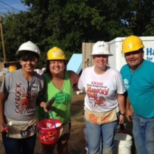 Habitat Volunteers working alongside future homeowners