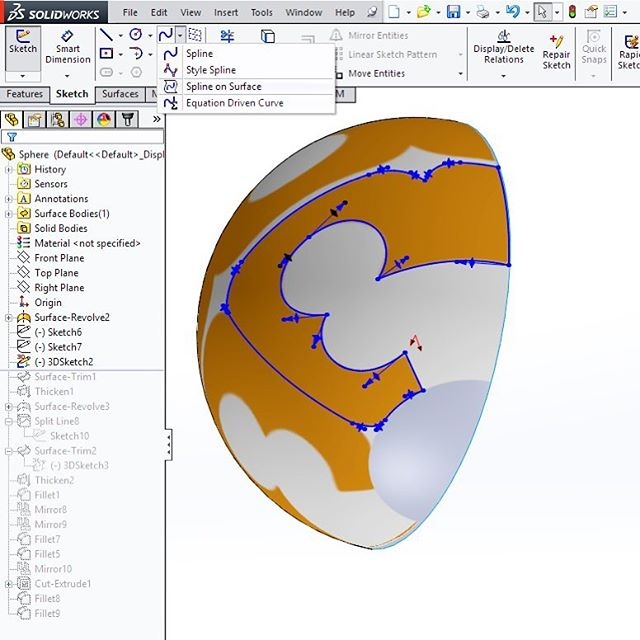 Picked up a new trick - splines on surface! I was struggling a lot with getting a good projection of an image on a sphere, and the usual dwg sketch on plane + projected split line didn't work well at all. After some googling around I found out about this tool + decals projection maps way better. . . . #solidworks #cad #productdesign #industrialdesign #design #process #keychain #tips