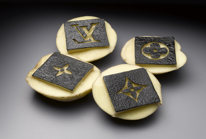 Yumi Janairo Roth,  Potato Stamp Louis Vuitton , 2010. Archival print of carved potatoes