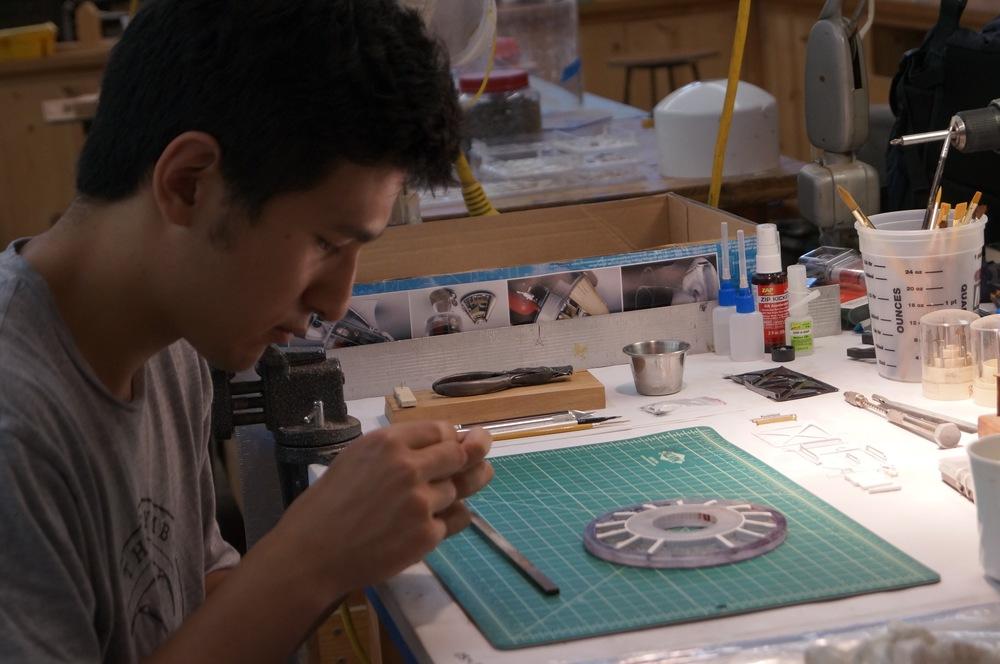 Luke Ban making models.