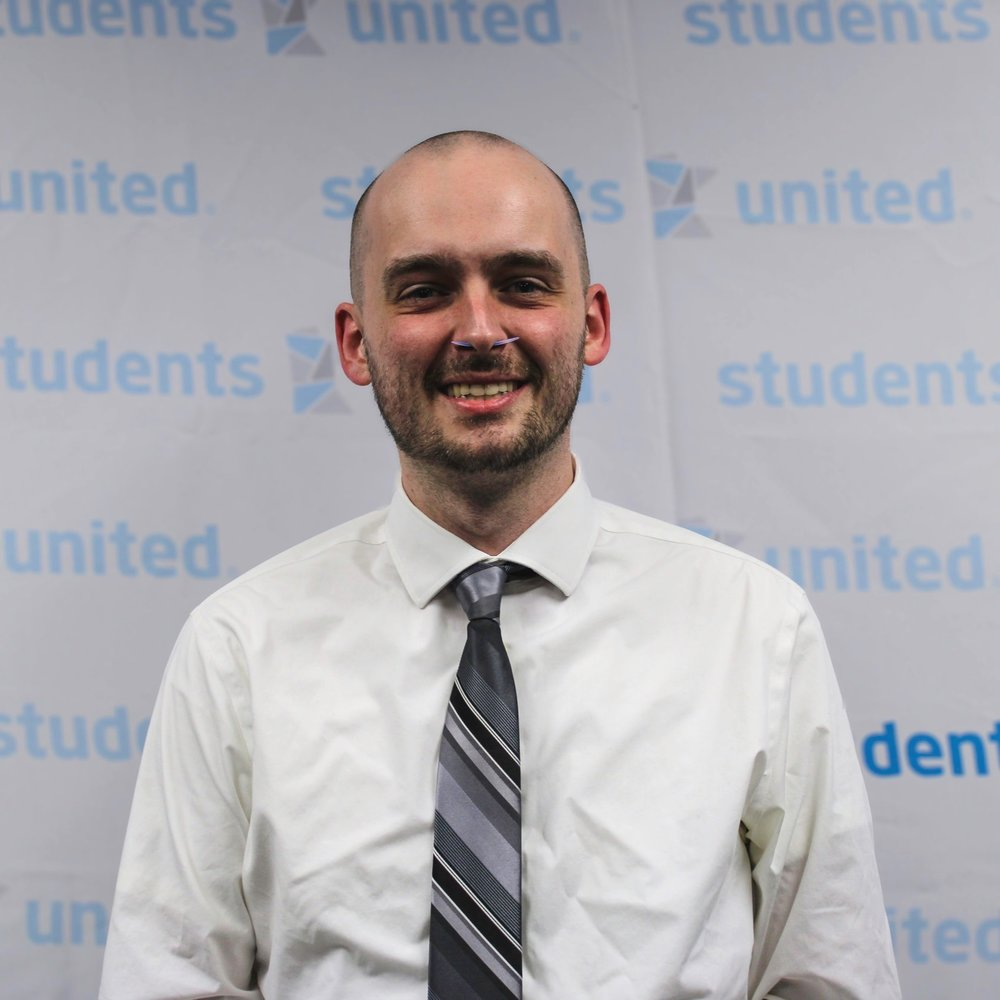 devin smith - campus and system liaisonDevin is a graduate of St. Cloud State where he received a Bachelor of Arts in Elective Studies, with a majority of credits coming from the communication studies department. He began his involvement with students united in his junior year at St. Cloud, and has since been to numerous delegates meetings as a student representative, a campus committee member, and finally as a staff member. Devin's academic interest in policy is unmatched, and he is willing to go to the mat over sloppy phrasing in governing documents any day of the week. Outside of Students United, you may find Devin at Level Up Games in West St. Paul losing consecutive Warhammer 40k matches or in a park befriending the local bird populace.