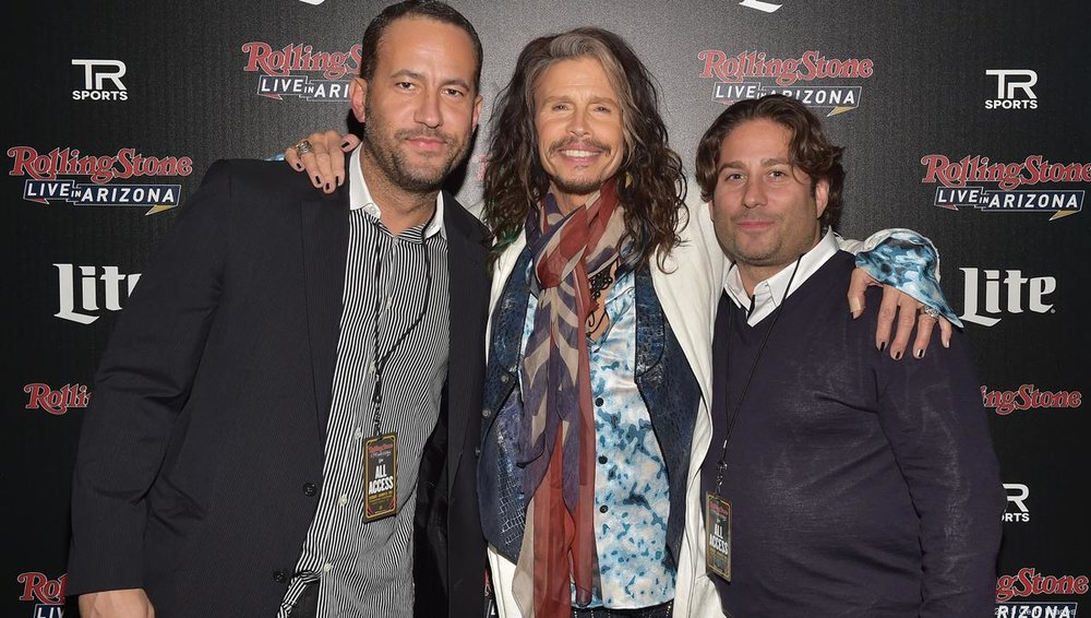 Steven Tyler (C) with co-founders and CEOs of TRS David Spencer (L) and Michael Heller (R) at Rolling Stone LIVE Arizona Presented by Talent Resources Sports