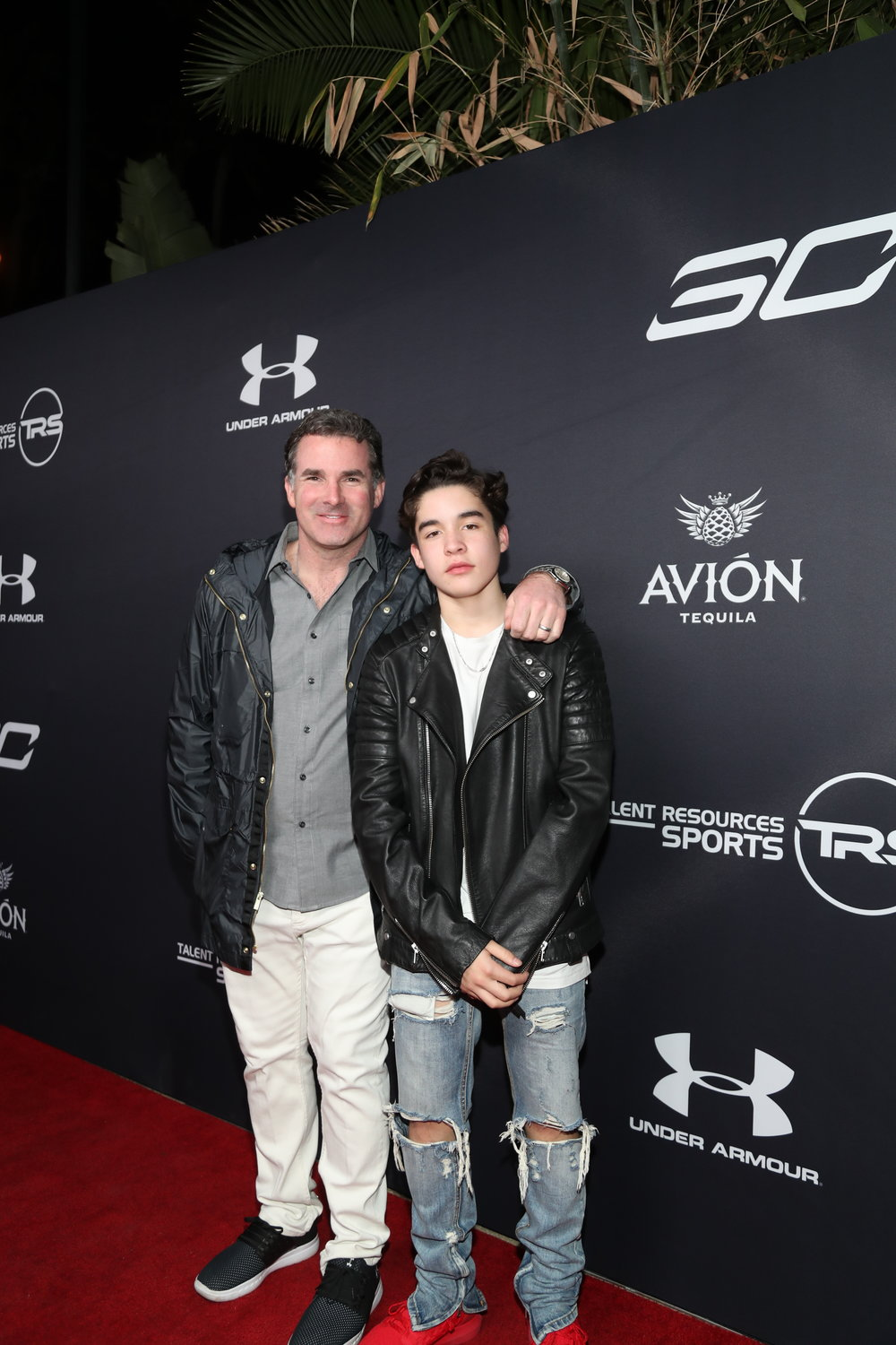 Under Armour CEO, Kevin Plank & son