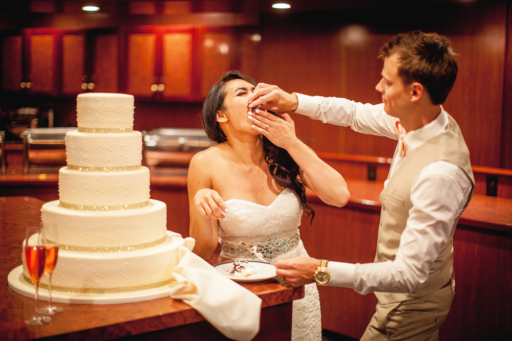 orange county wedding event planner cake shoved in face