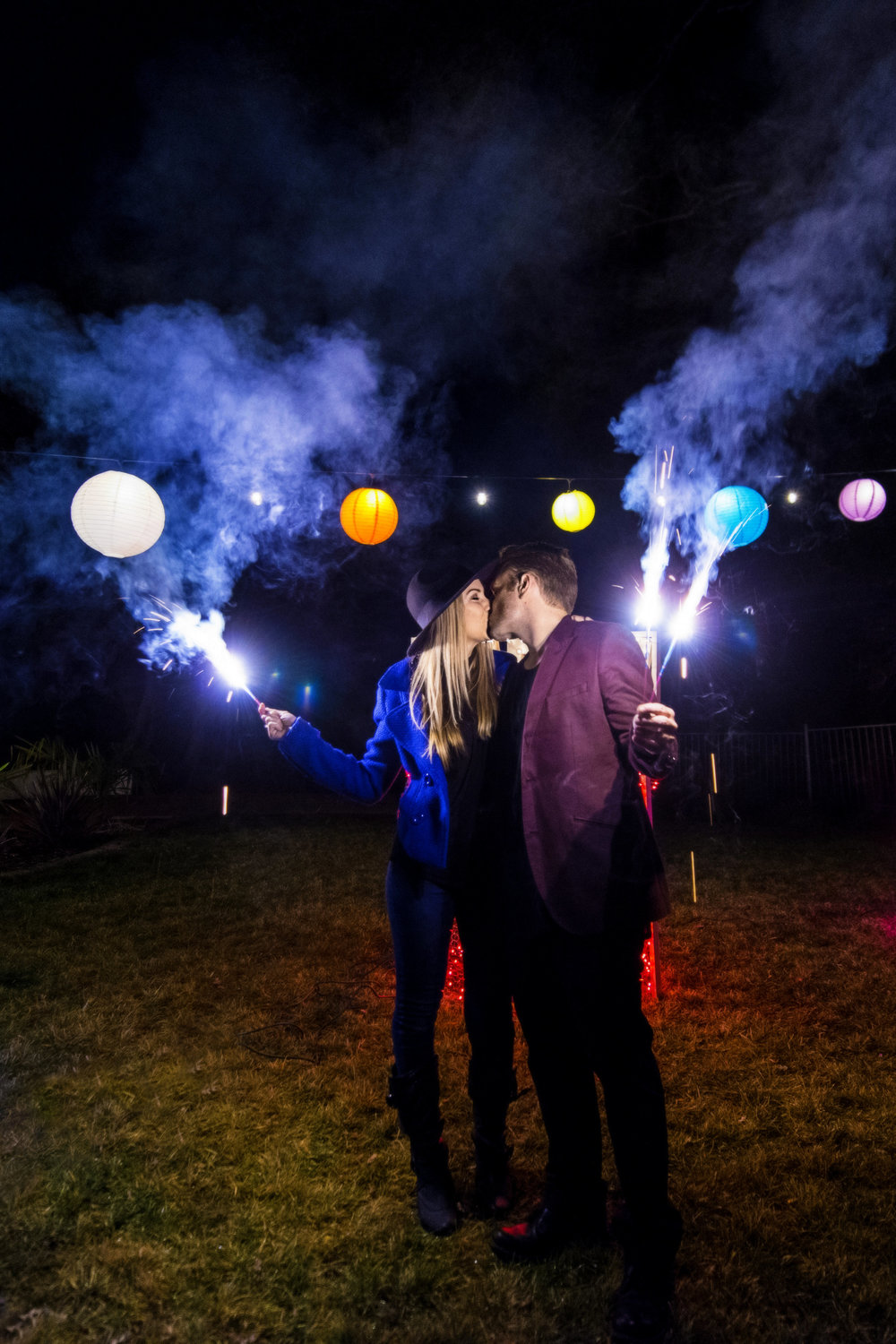 orange county wedding event planner nighttime sparklers kissing