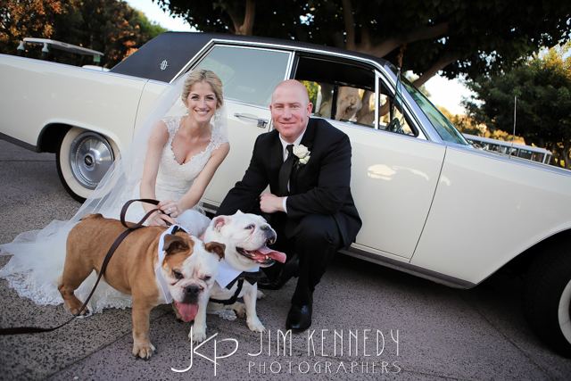 orange county wedding event planner bride and groom with their dogs