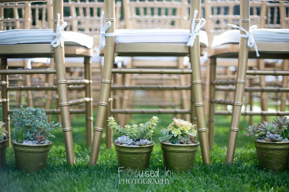 orange county wedding event planner chairs with planters