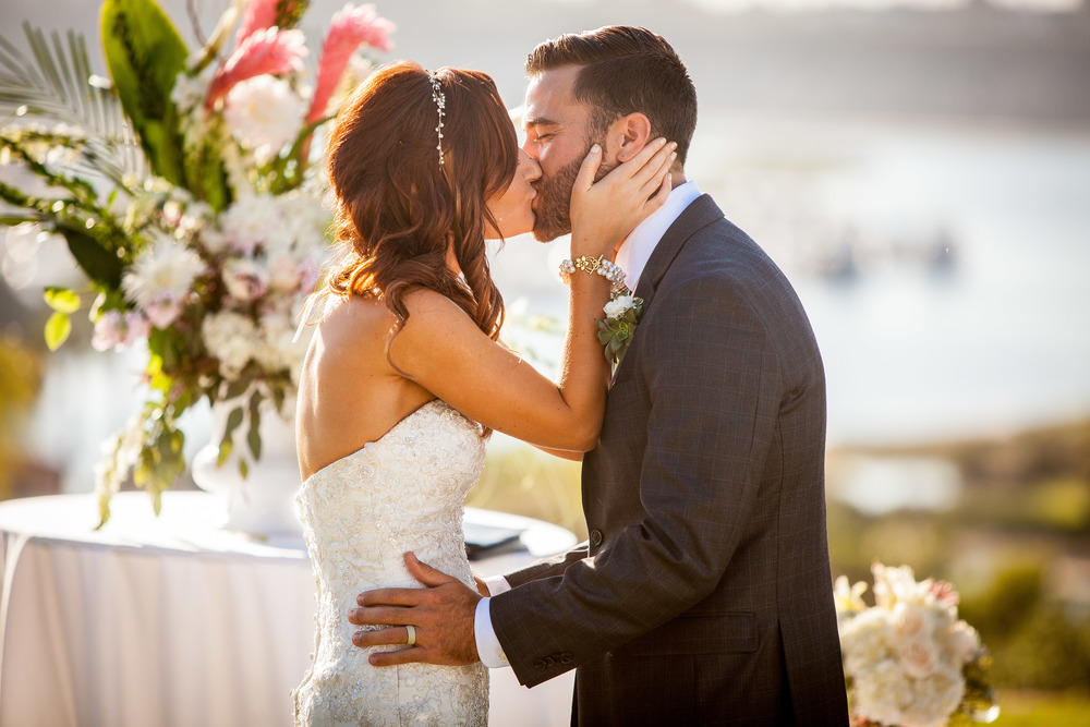 orange county wedding event planner kissing