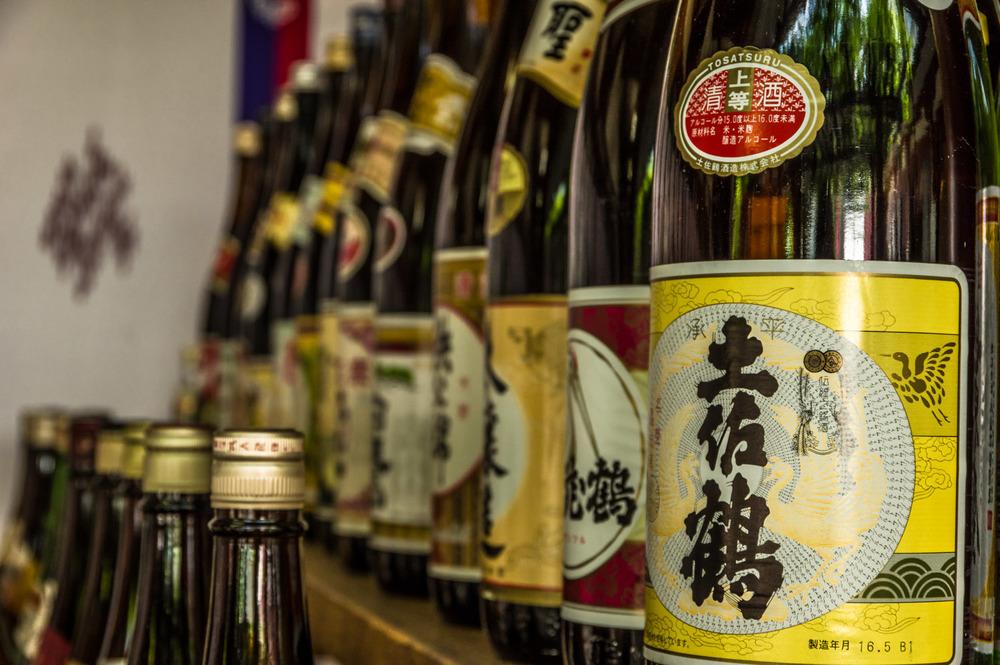 Bottles of sake on display