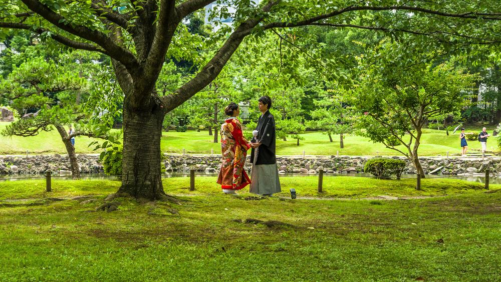 A couple having their wedding photos taken - can you spot the photographer?