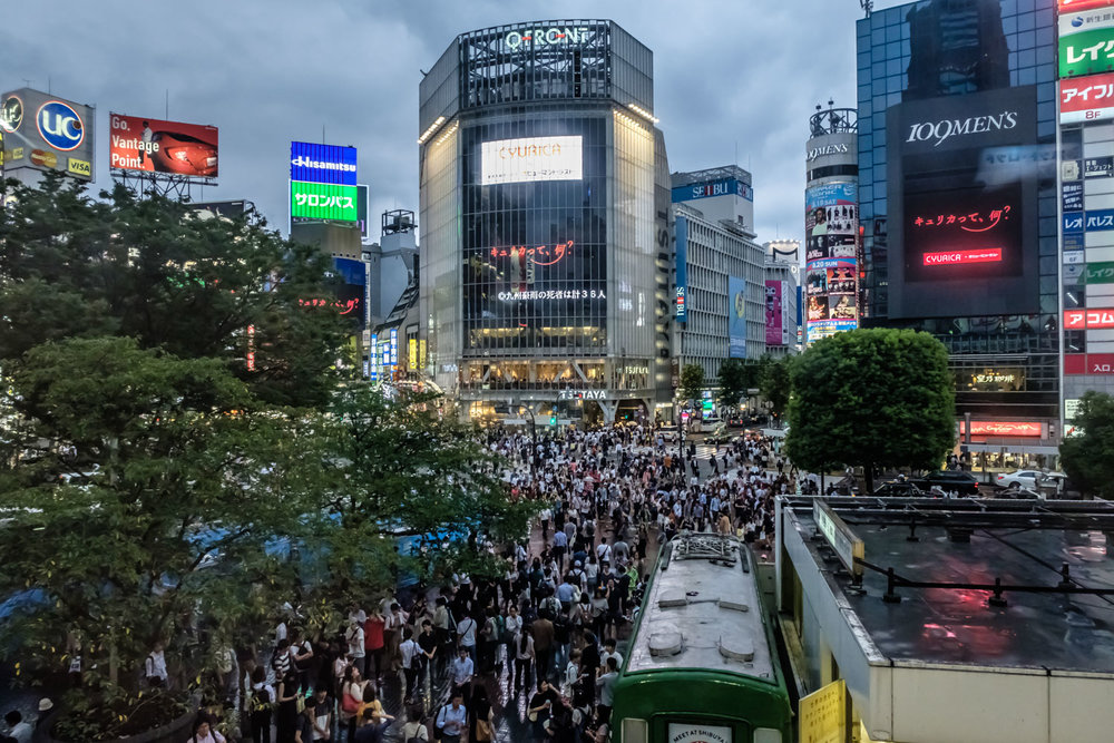 Shibuya crossing on a rainy Wednesday evening