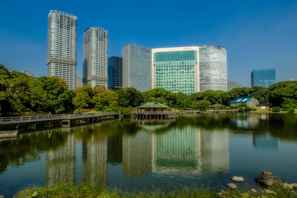 The main pond of Hama Rikyu with the skyscrapers of the Shiodome area behind