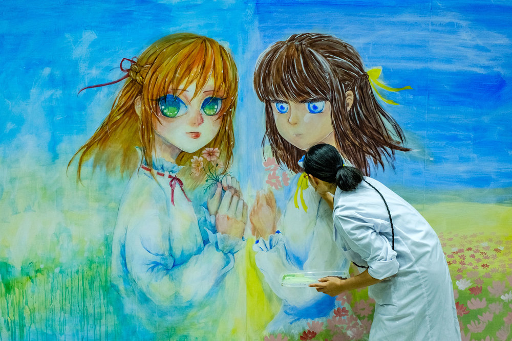 One of the mural being painted during the event - this one was my favourite