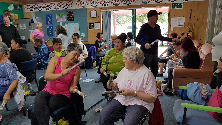 Waikawa Sit n' Be Fit participants enjoying 'Tītī tōrea' to music
