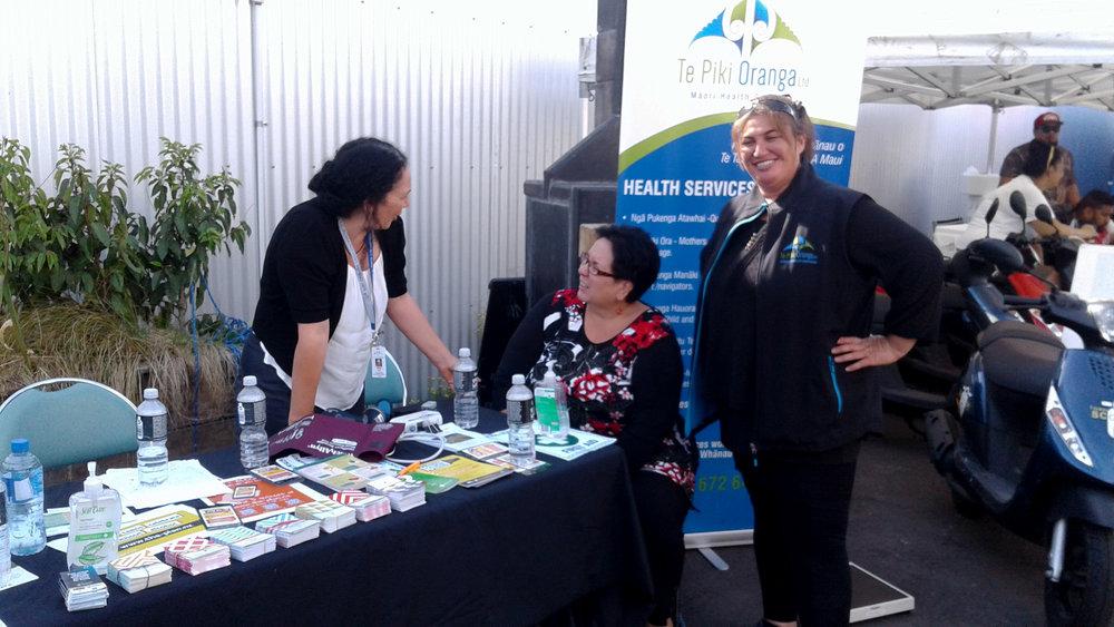 TPO nurse Marissa Scott talks with Rayma-Lee Kotu with AOD Clinician Debbie Tauwhare's support