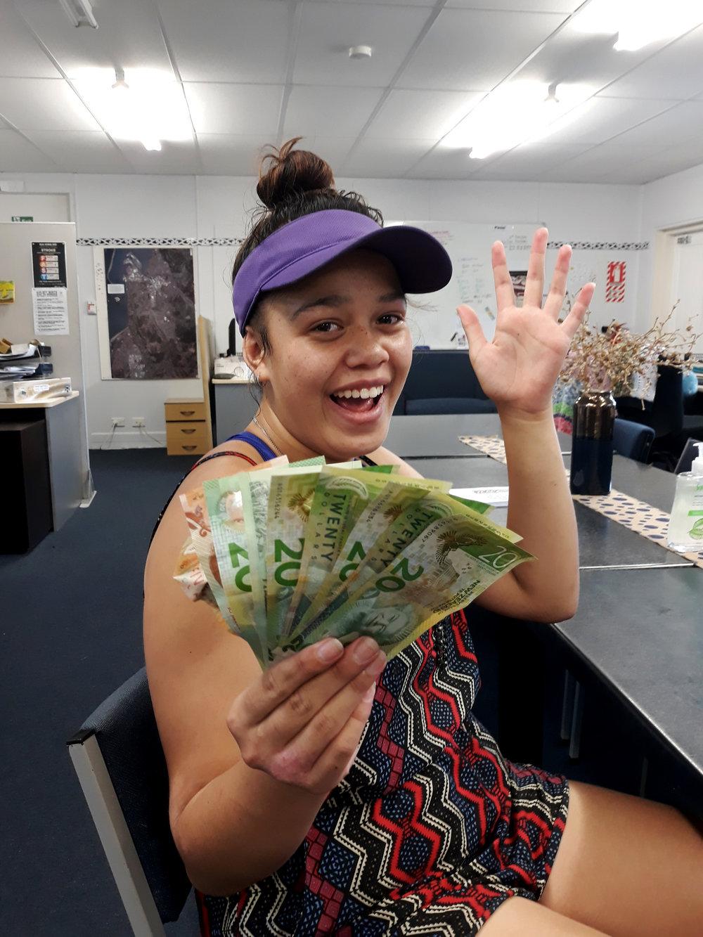 Waimaria showing off her hard earned cash from car washing