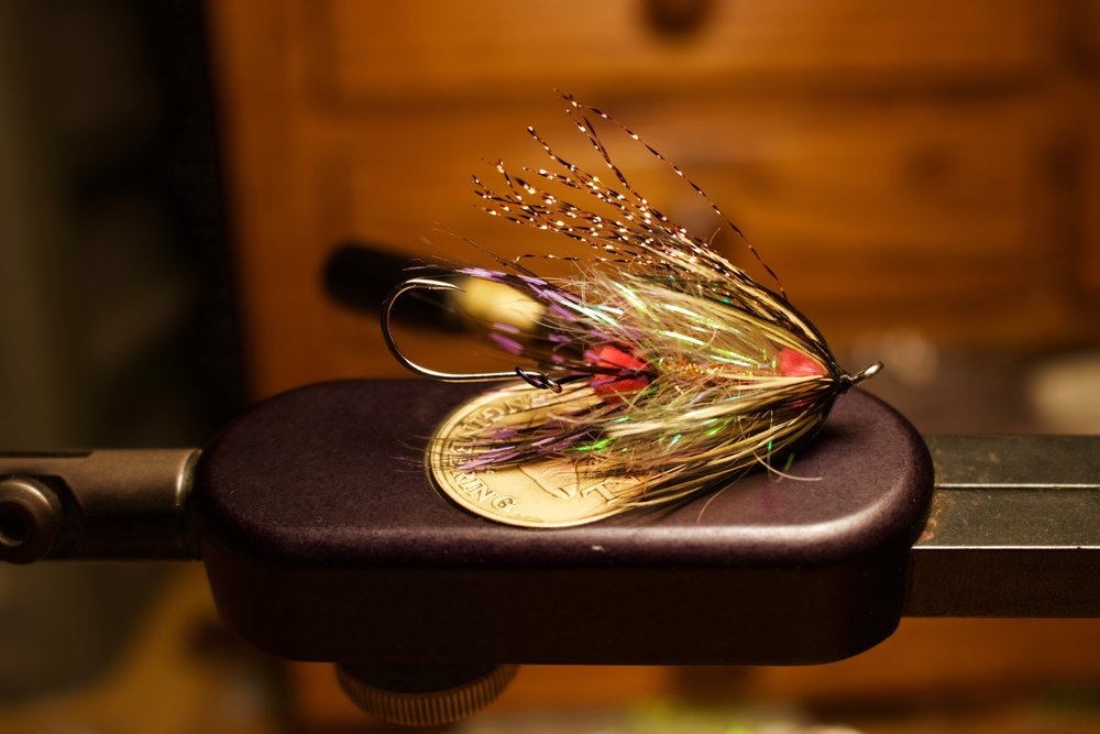 A simple unweighted intruder style fly with a flash body and copper flash wing. Tied on a 35mm Partridge shank with a Sz4 owner on the business end.