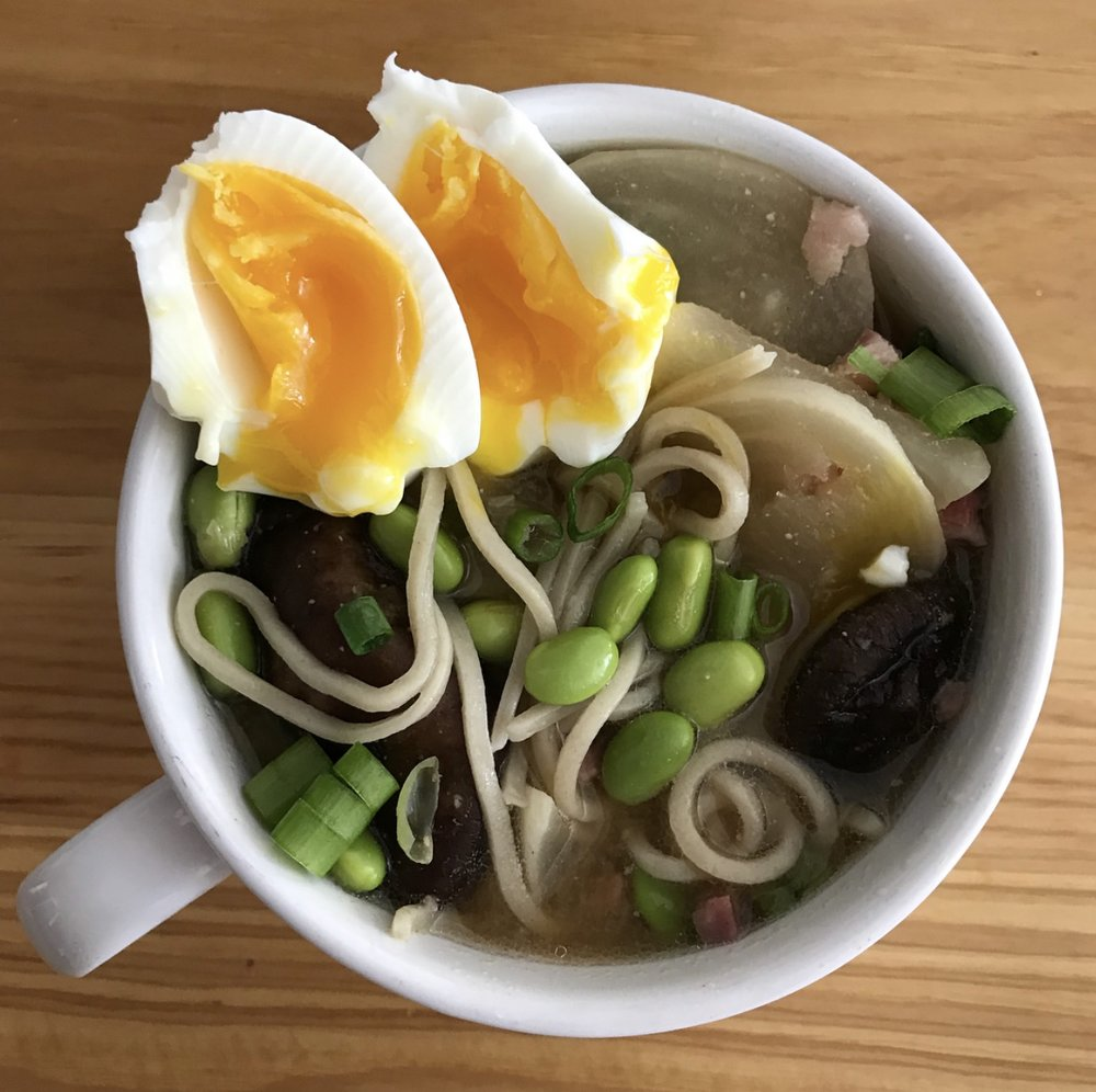 Miso ramen bowl with pancetta, edamame, and soft-cooked eggs.  The real deal.  No fancy photog.  Just the goods on my kitchen counter.  Scroll down for the link to the recipe!