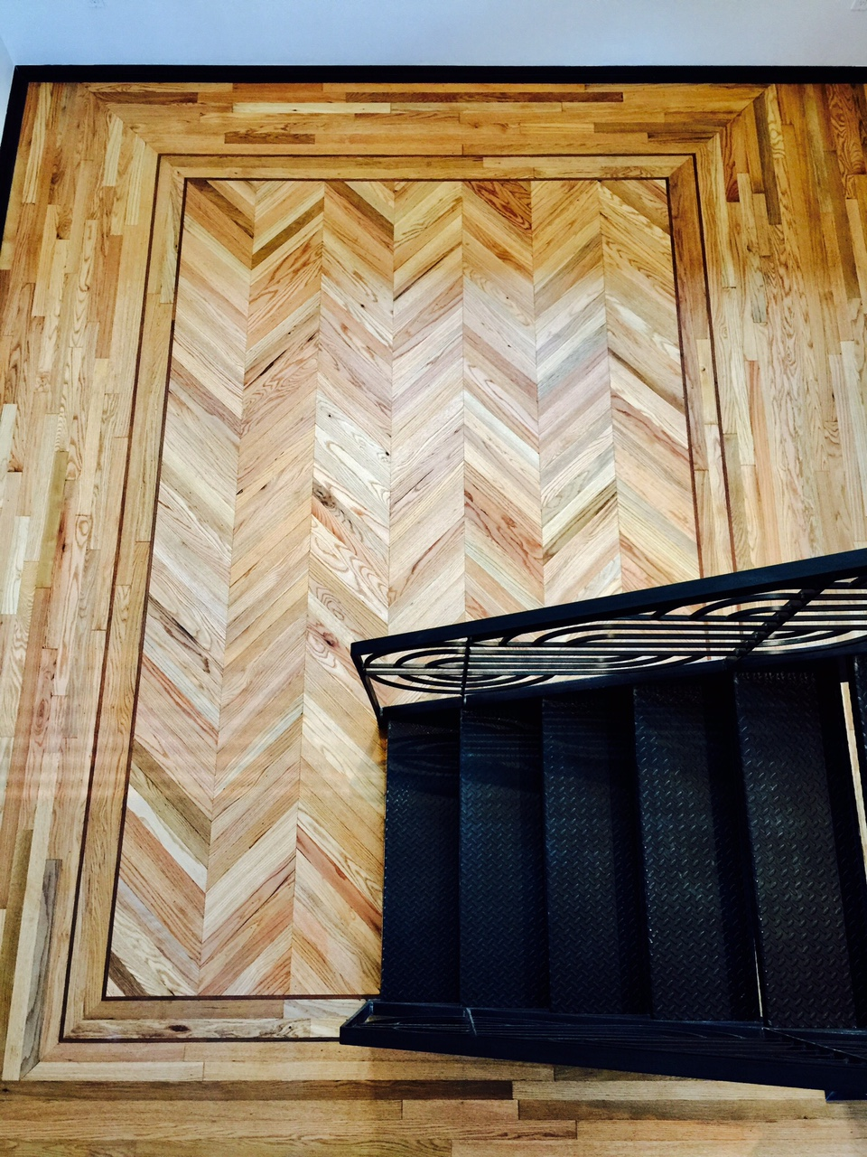 Chevron flooring with Mahogonney inlay.JPG