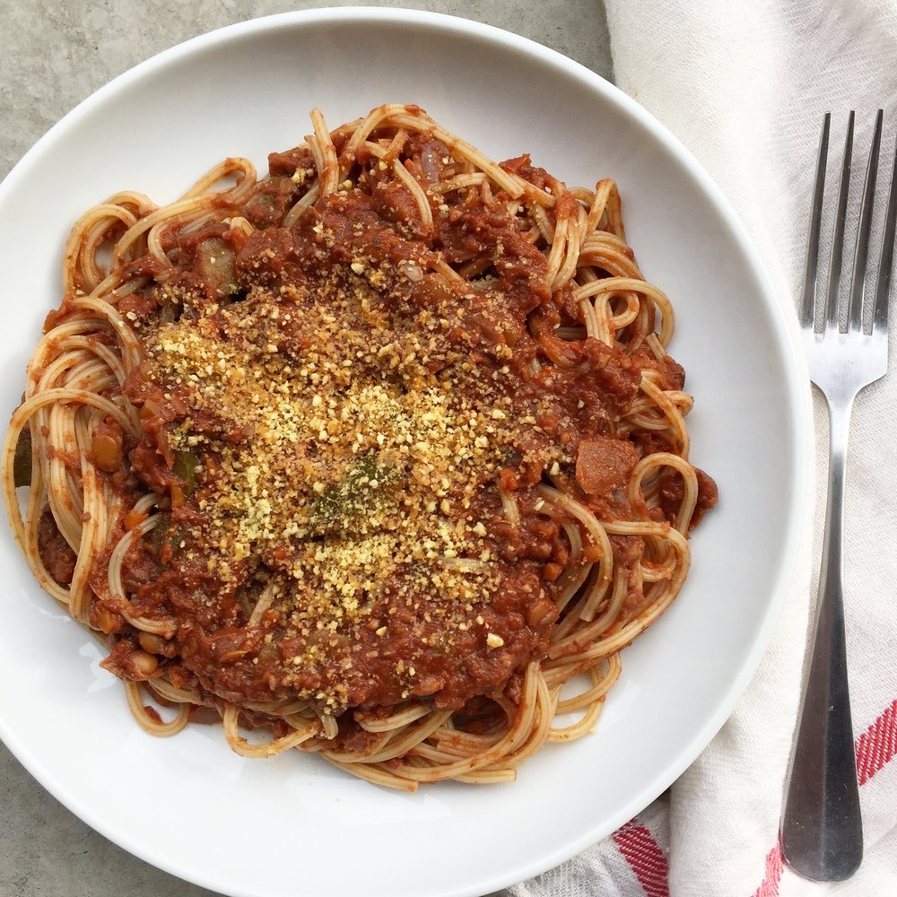 Lentil-walnut bolognese with mushrooms; homemade almond parmesan