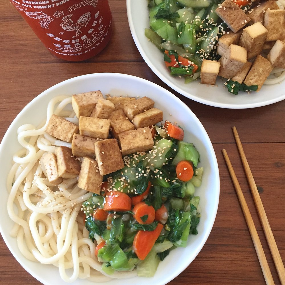 Bok choy and carrot stir fried with tamari, garlic, and cornstarch to thicken; tamari-soaked tofu; udon noodles