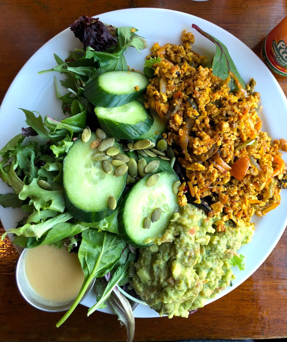Tofu scramble from the Naam, with plenty of guacamole and a delicious salad dressing on the side.