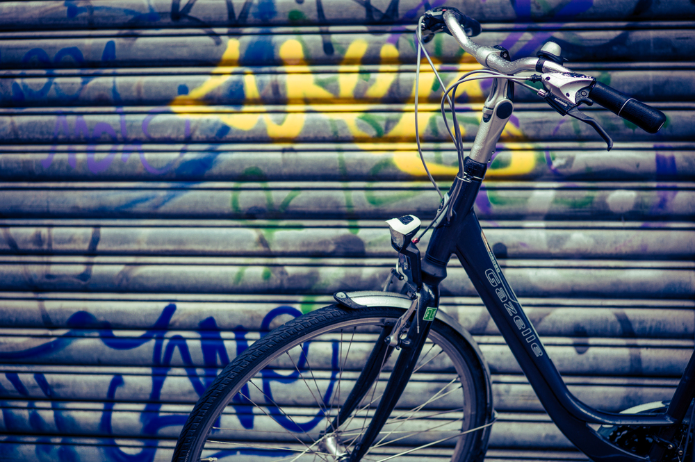 Bicycle in Front of Graffiti