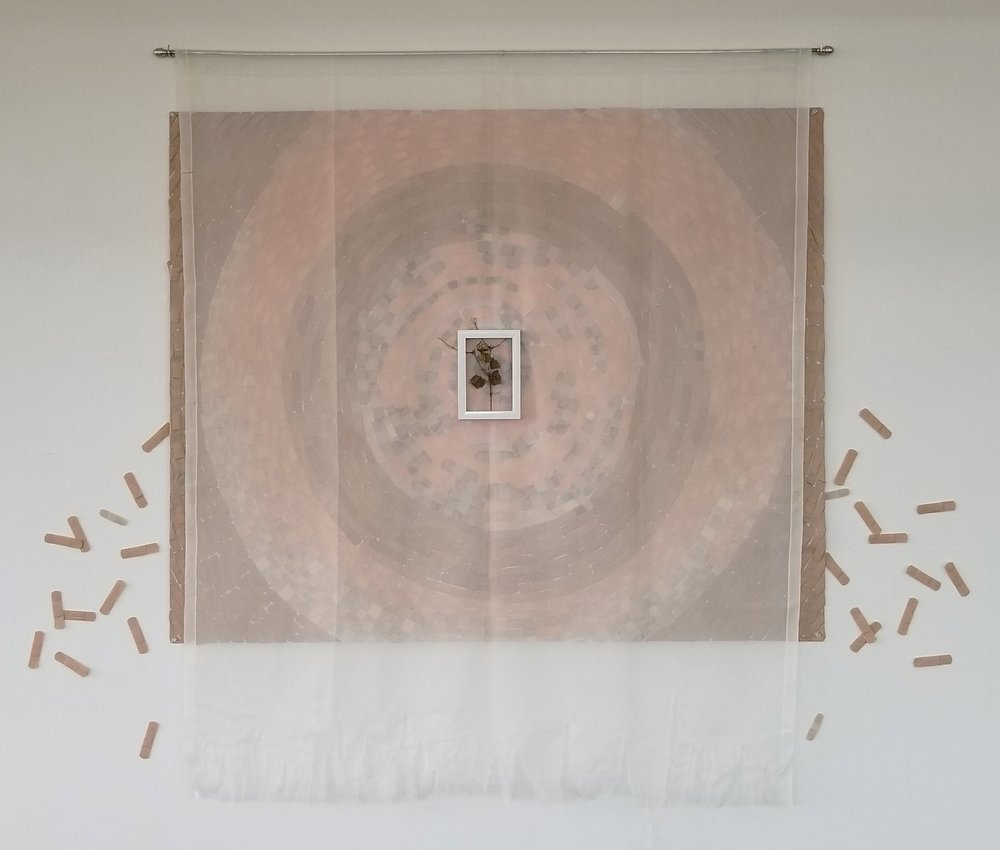 "Mikayla   2017 adhesive bandages, sheer curtain, curtain rod, picture frame, tree branch, leaves 58"" x 72"" x 1"" (overall)"