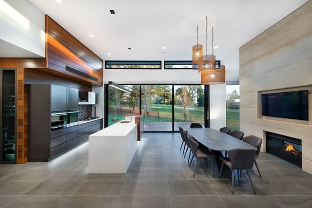 Refined interior forms and palate are inspired by nature, the site and  surrounds, leaving the view as the number one feature. The kitchen and dining space opens up to a deck that overlooks the golf course.  Interiors by us, architecture by @design_unity, build by #herbelconstructions 📷 by #matthewmallett  #martinjscottdesign #mjs #residentialdesign #warrigalresidence #villaessence