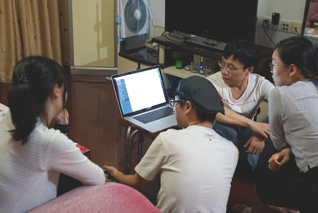 Thanks to our friend Fred, we finally had some co-working picture. From left to right: Betty(Artist), Fox(Manager), W.Guan(Programmer) and W.Qian(Musician)