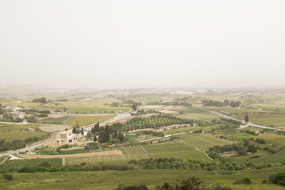 View of the countryside from Mdina with the overcast dusty sky.