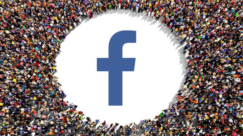 Cover image from column, a Facebook logo surrounded by a crowd of people.