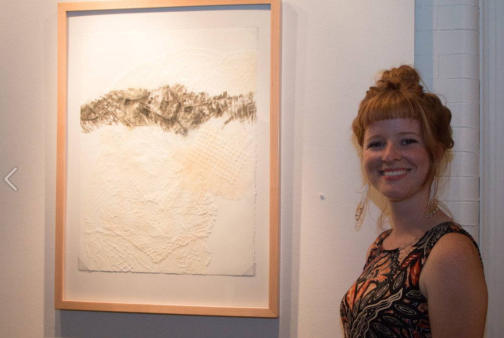 Graduate student Molly Markow poses alongside her work. Photo Courtesy: Justine Kaszynski Photography