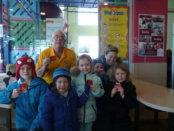 Back row: Lion Jack Ruck and Stacey Low. Front Row: Ryder Burke, Jack Parker, Violet Parker, Jensen Low and Calihan Low get ready to enjoy their Happy Meals. - Georgetown Lions Club/photo