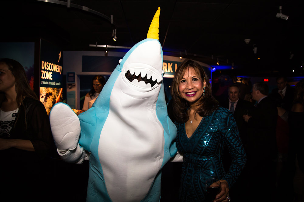 Ned the Narwhal with event emcee, Susette Tibus