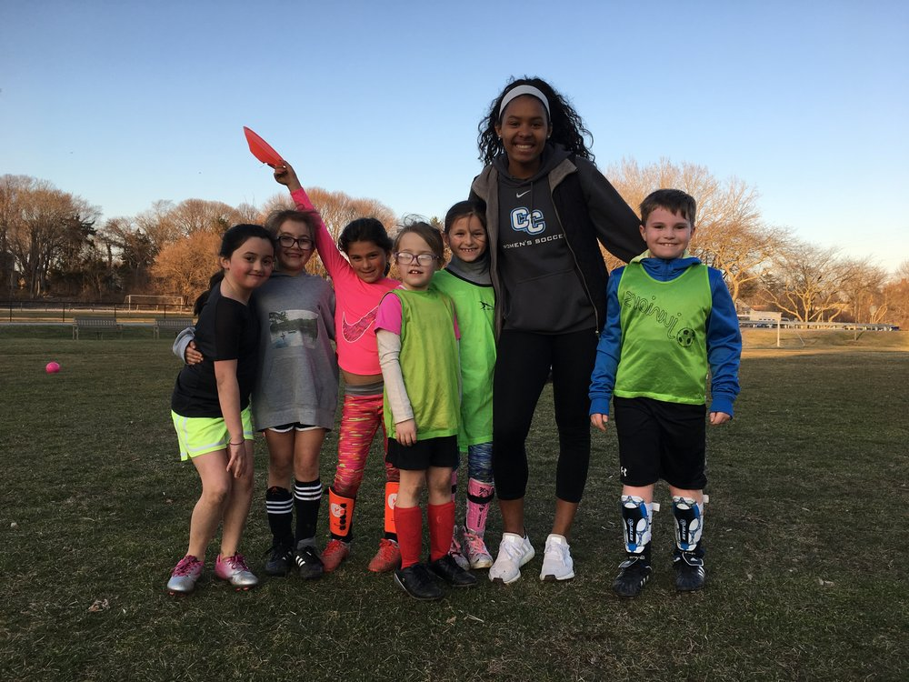 Assistant Coach Mia from Connecticut College Women's Soccer with COMO U8 players.