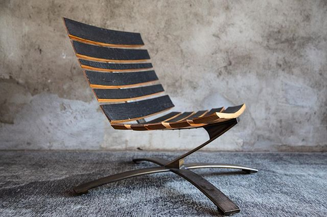 Lean into Hump Day with our Signature Bilge lounge chair. Charred bourbon barrel staves sit atop reclaimed leaf springs for a subtle bounce and a surprisingly comfortable seat. 🥃 ⠀ ⠀ _____________________________________________ ⠀ ⠀ #reclaimed #sustainable #loungechair #charred #narrativedesign #sustainabledesign #furnituredesign #chair #highend #interiordesign #modernrustic #uhurudesign #newamericandesign ⠀