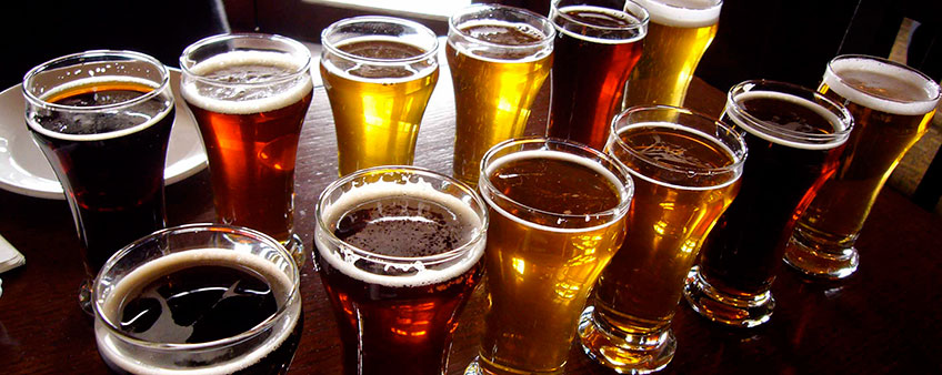 beer-glasses-lined-up-on-bar.jpg