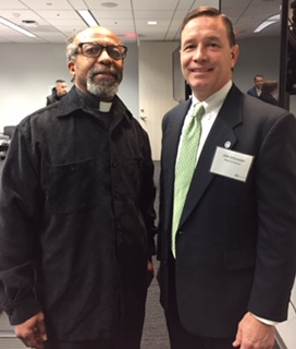Rev. Killings with the regional director of the CFPB
